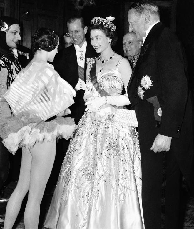 1957: The Duke of Edinburgh attends a soirée at Paris' Palais Garnier in honour of his wife, Queen Elizabeth