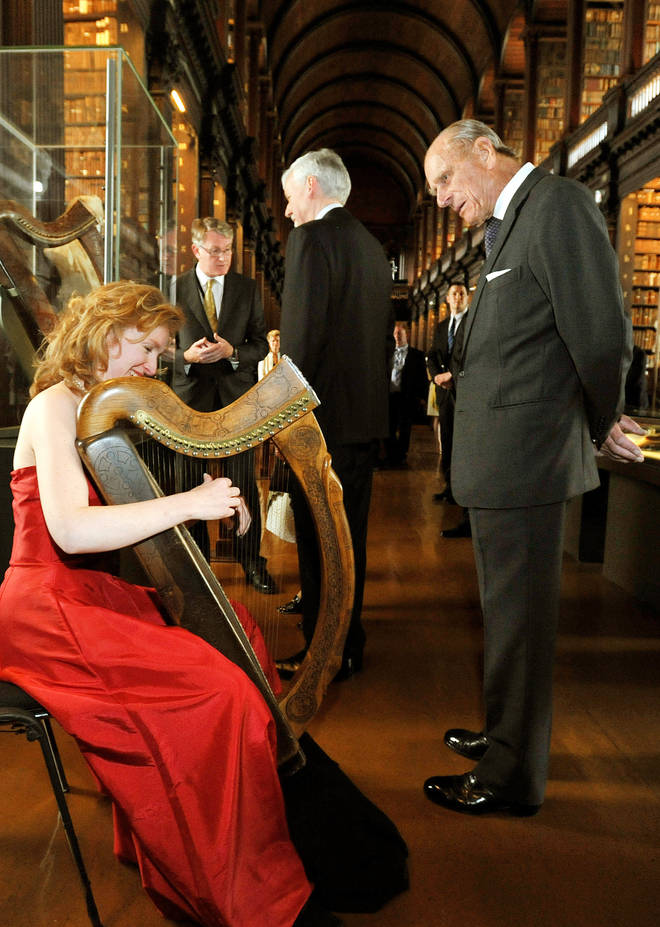 2011: The Duke of Edinburgh listens to harpist Siobhan Armstrong play a traditional Irish harp during a tour at Trinity College in Dublin