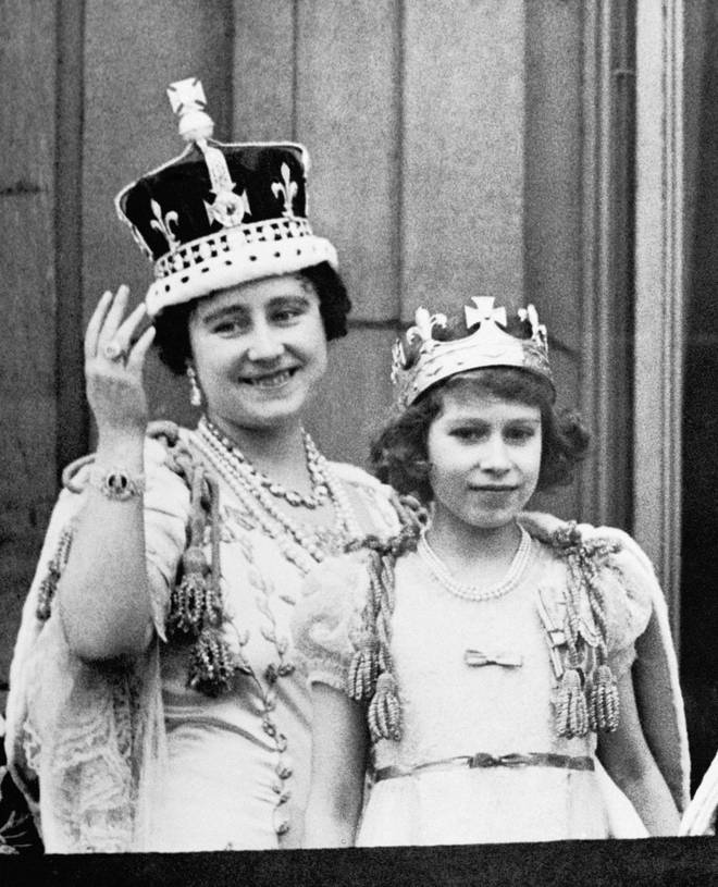 Princess Elizabeth stands with her mother, Queen Elizabeth, on the balcony of Buckingham Palace following the coronation of King George VI.