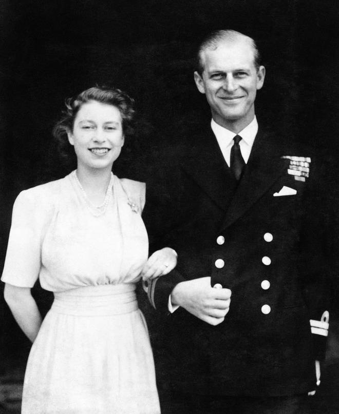 Princess Elizabeth and Lieutenant Philip Mountbatten smile during their first engagement pictures, taken at Buckingham Palace.