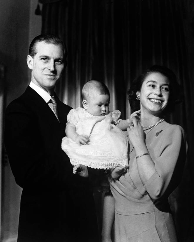 Princess Elizabeth and The Duke of Edinburgh hold their first child Prince Charles, aged six months