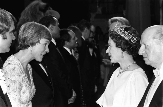 Queen Elizabeth II chats to actress Julie Andrews backstage at the London Palladium