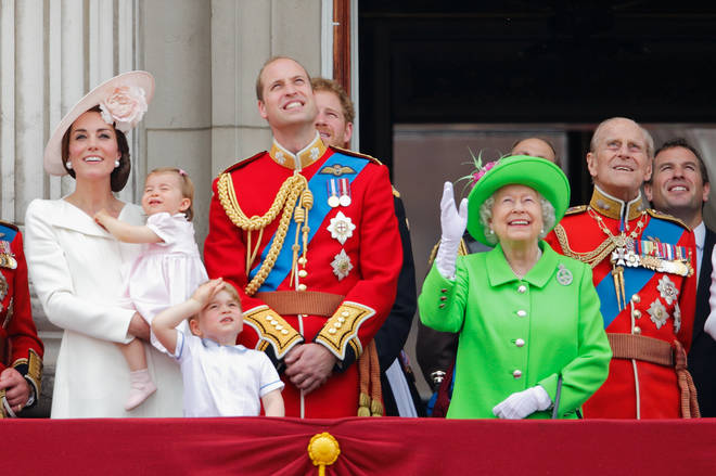 The Queen and Royal Family stand together on the balcony of Buckingham Palace during the Trooping The Colour