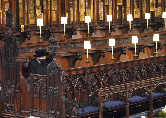 The Queen sits alone during the funeral of Prince Philip at St. George's Chapel