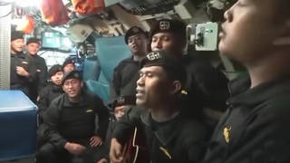 Crew of destroyed Indonesia submarine sing poignant farewell song