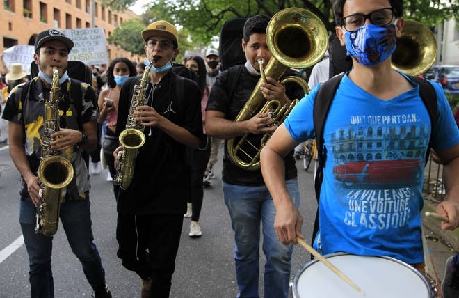 Musicians play in the march during a new day of protests in Medellín, Colombia