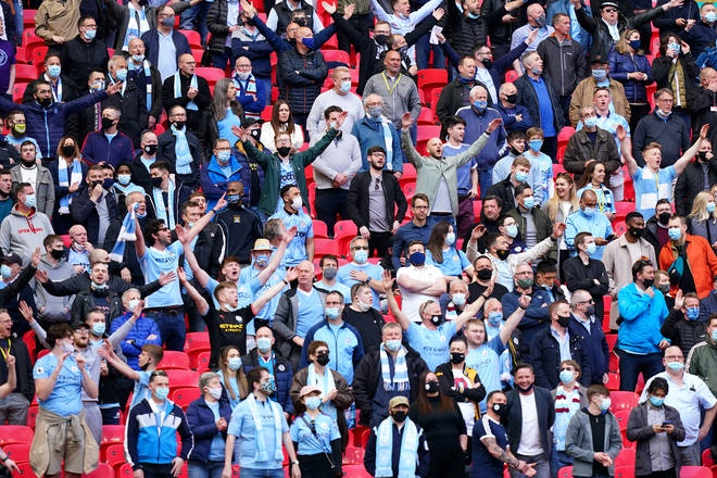 Manchester City fans sing in full voice at Wembley Stadium on April 25, 2021 in London, England