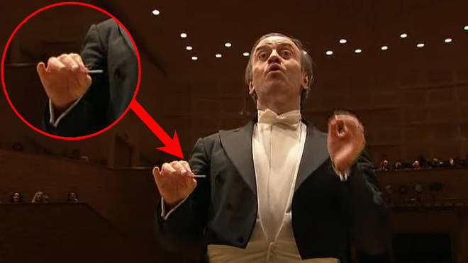 Watch this maestro conduct an entire symphony orchestra using a toothpick as a baton
