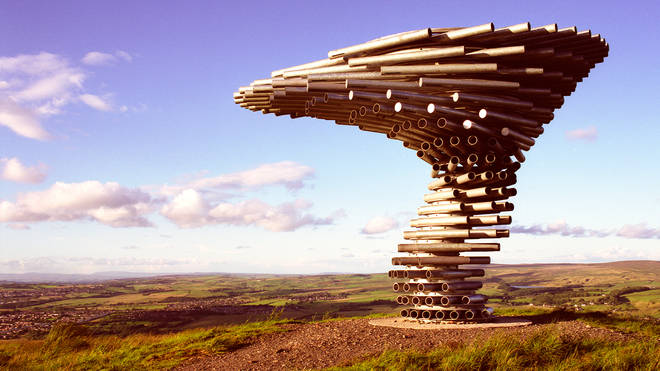 The 'Singing Ringing Tree' sits atop a hill overlooking Burnley
