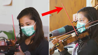 Incredible footage shows young, one-handed girl playing violin with ingenious prosthetic device