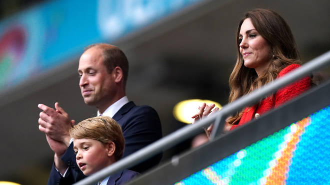 Prince William, Prince George and the Duchess of Cambridge watching England v Germany