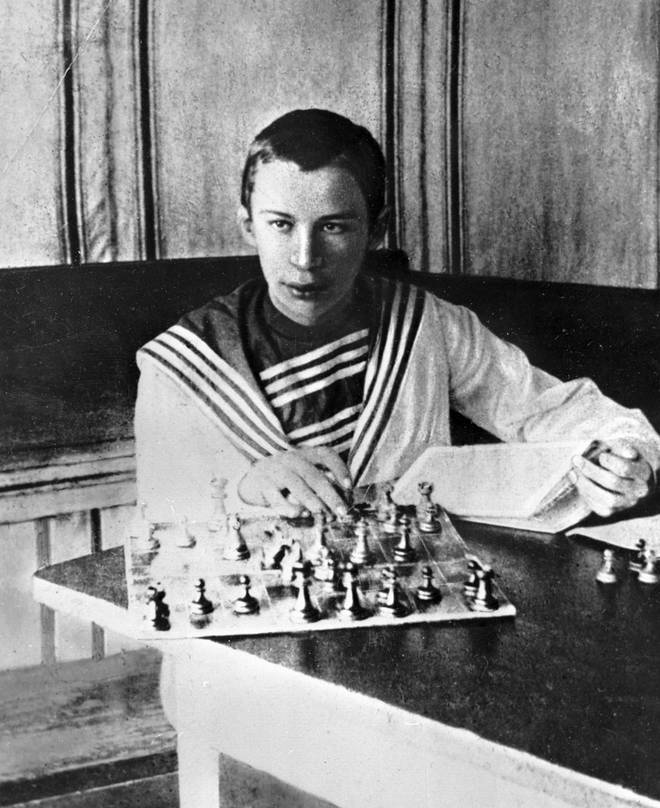 Young Sergei Prokofiev playing a highly competitive game of chess.