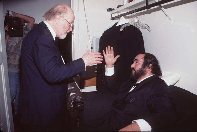 John Williams and Luciano Pavarotti clasping hands at the Grammy Awards. (1999)