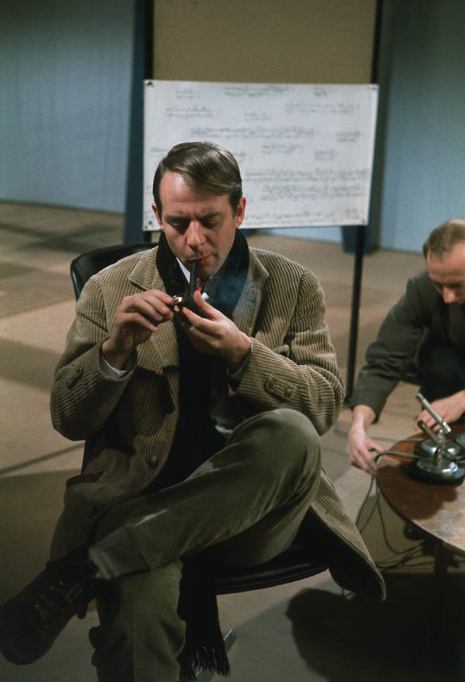 German composer Karlheinz Stockhausen smokes a pipe during a recording session