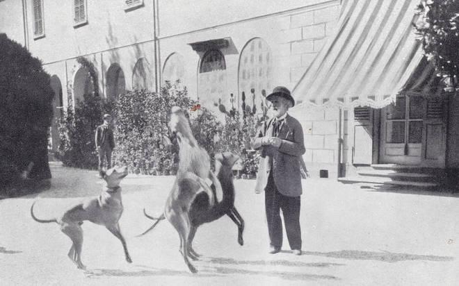 Italian opera composer Giuseppe Verdi with his dogs. (1800s)