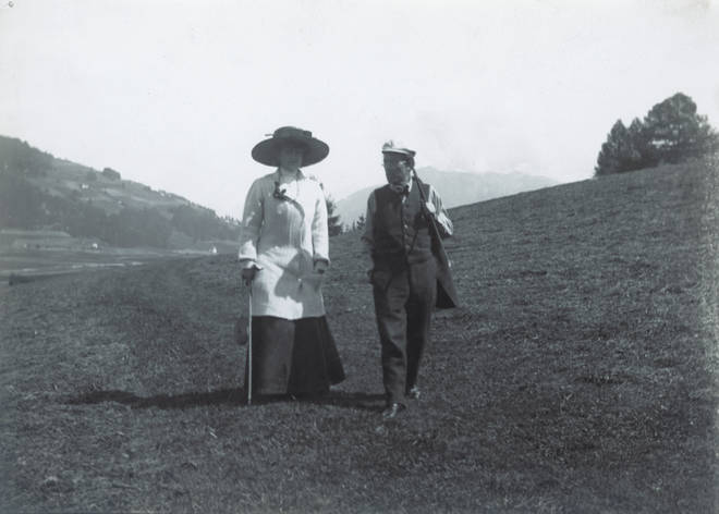 Austrian composer Gustav Mahler and his wife Alma take a stroll nearby their summer residence in Toblach. (1909)