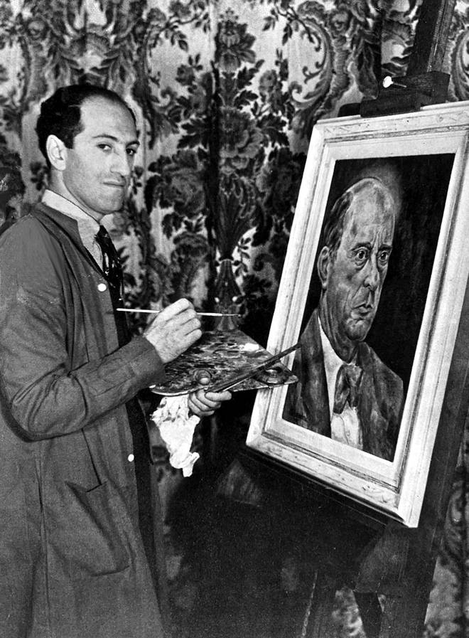 George Gershwin photographed while painting a portrait of Austrian composer Arnold Schonberg