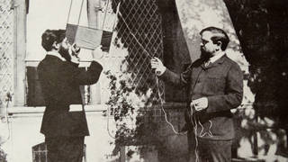 Claude Debussy flying a kite with Louis Laloy.