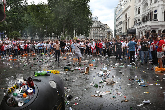 England fans leave a trail of litter across London's Leicester Square.