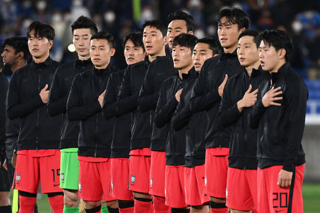 South Korea's players sing the national anthem prior to a friendly football match with Japan