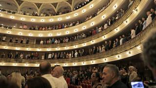 Cuba's President Miguel Diaz Canel listens to the national anthem at the Festival International de Ballet