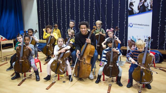 Sheku with children from Prior Weston Primary School