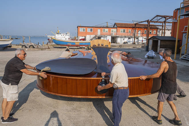 Livio De Marchi and team with their musical boat