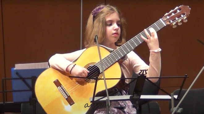 7-year-old classical guitar virtuoso plays with extraordinary passion and precision