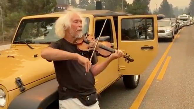 As Californians rush to escape wildfire, a solo violinist brings calm to traffic jam