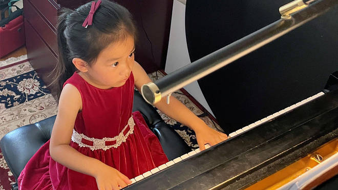 Brigitte Xie, 4, plays piano at piano teacher Felicia Feng Zhang's home in Greenwich, Connecticut, U.S. July 31, 2021.