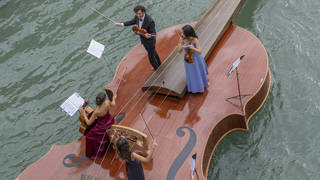 Watch a sublime string quartet serenade Venetians with Vivaldi on a boat shaped like a violin