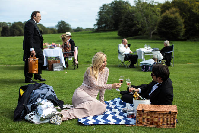 Glyndebourne festival goers attend a picnic during the interval