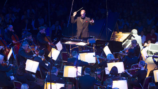 Timothy Henty conducts the Royal Liverpool Philharmonic Orchestra, during Classic FM Live, at the Royal Albert Hall in London