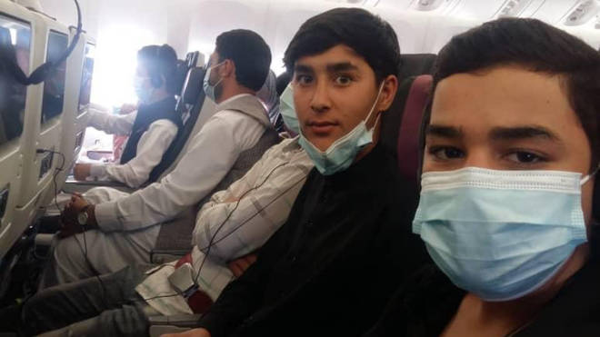 Students from the Afghanistan National Institute of Music on a plane to Doha
