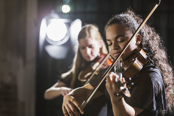 String players performing
