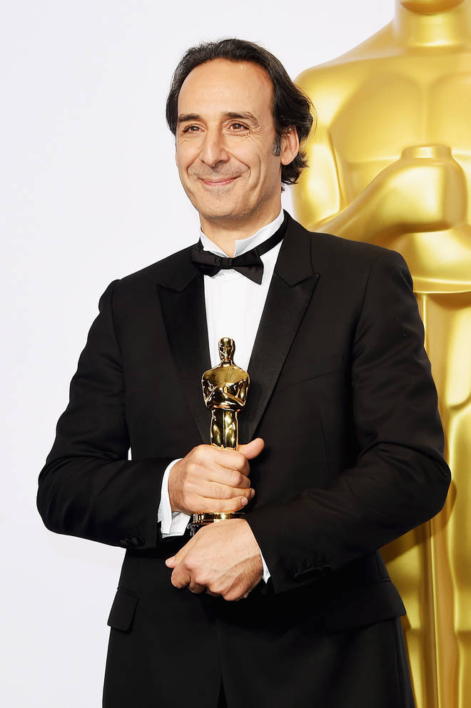 Alexandre Desplat holding his Oscar for 'The Grand Budapest Hotel'