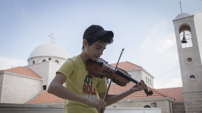 Aboud Kaplo plays the violin