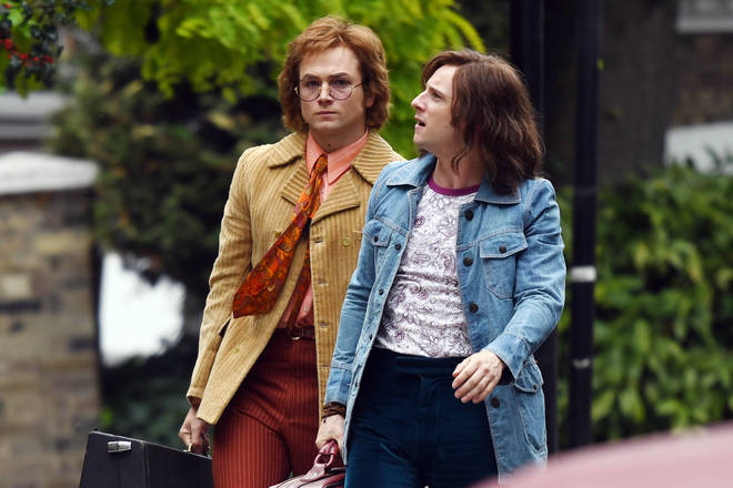 Taron Egerton and Jamie Bell on the set of Rocketman
