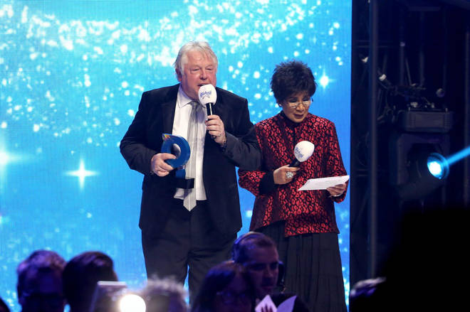 Nick Ferrari and Moira Stuart on stage at The Global Awards 2019 with Very.co.uk