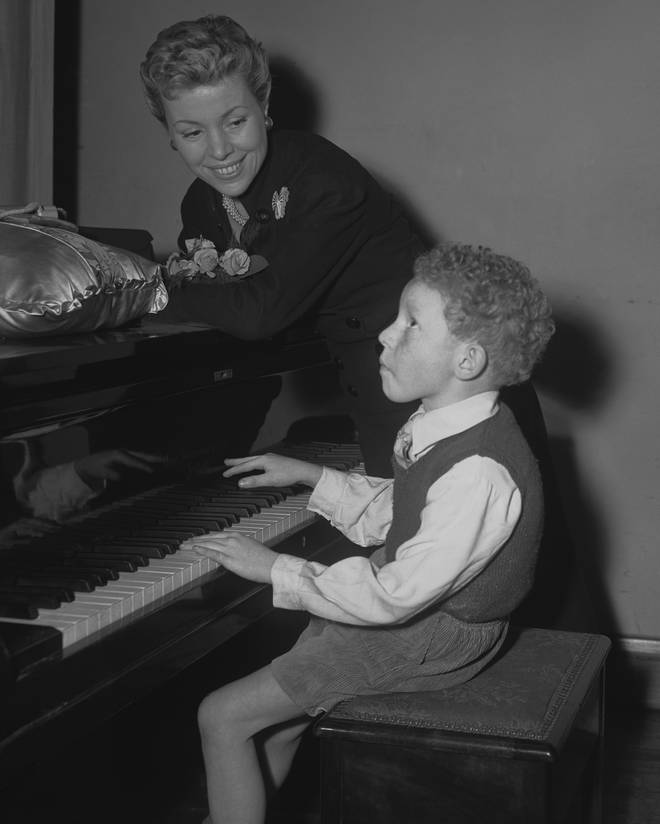 Roy Budd plays the piano as a 7-year-old boy