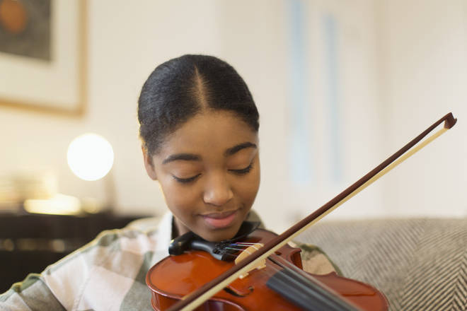 Teenage girl playing the violin