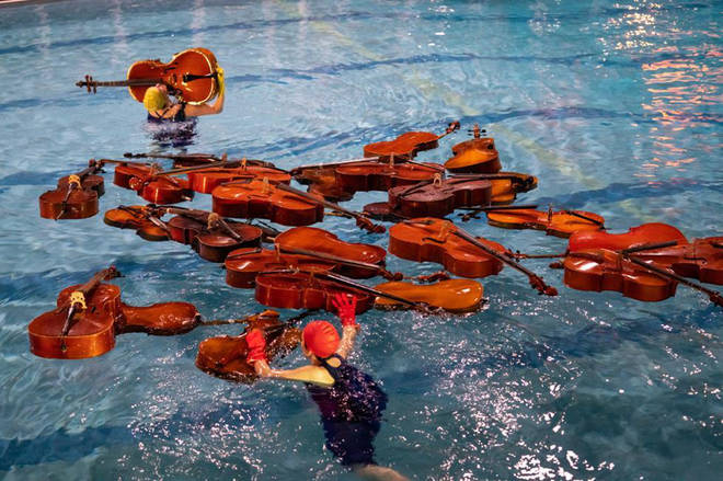 30 cellos in a swimming pool