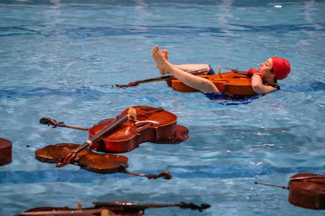 Cellos in a swimming pool