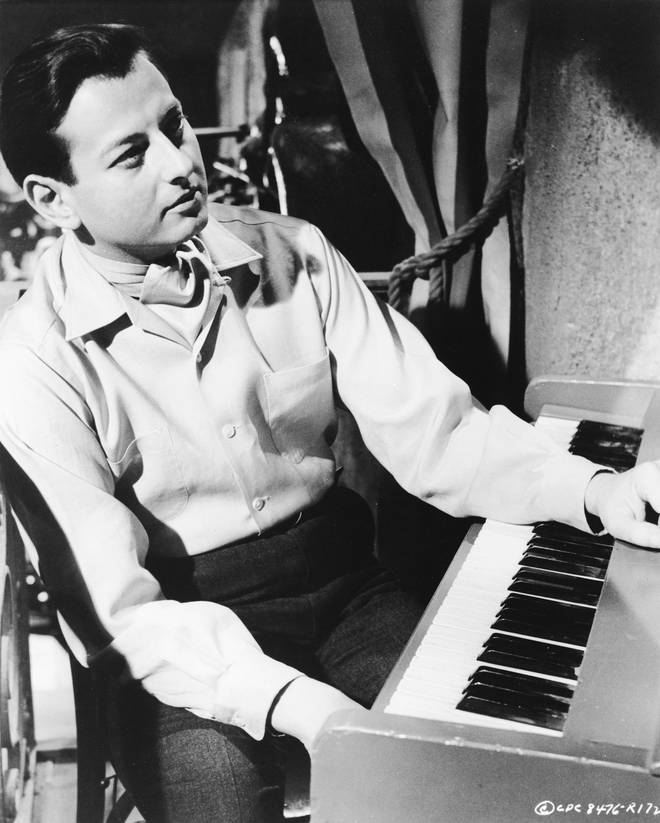 A young André Previn sits at a keyboard