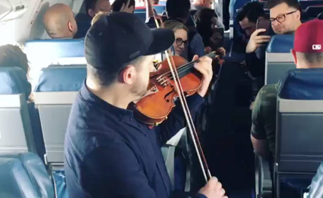 Violinist plays for airline passengers