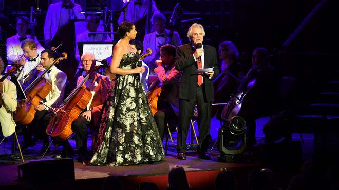 Classic FM Presenters Margherita Taylor and John Suchet on stage at the Royal Albert Hall