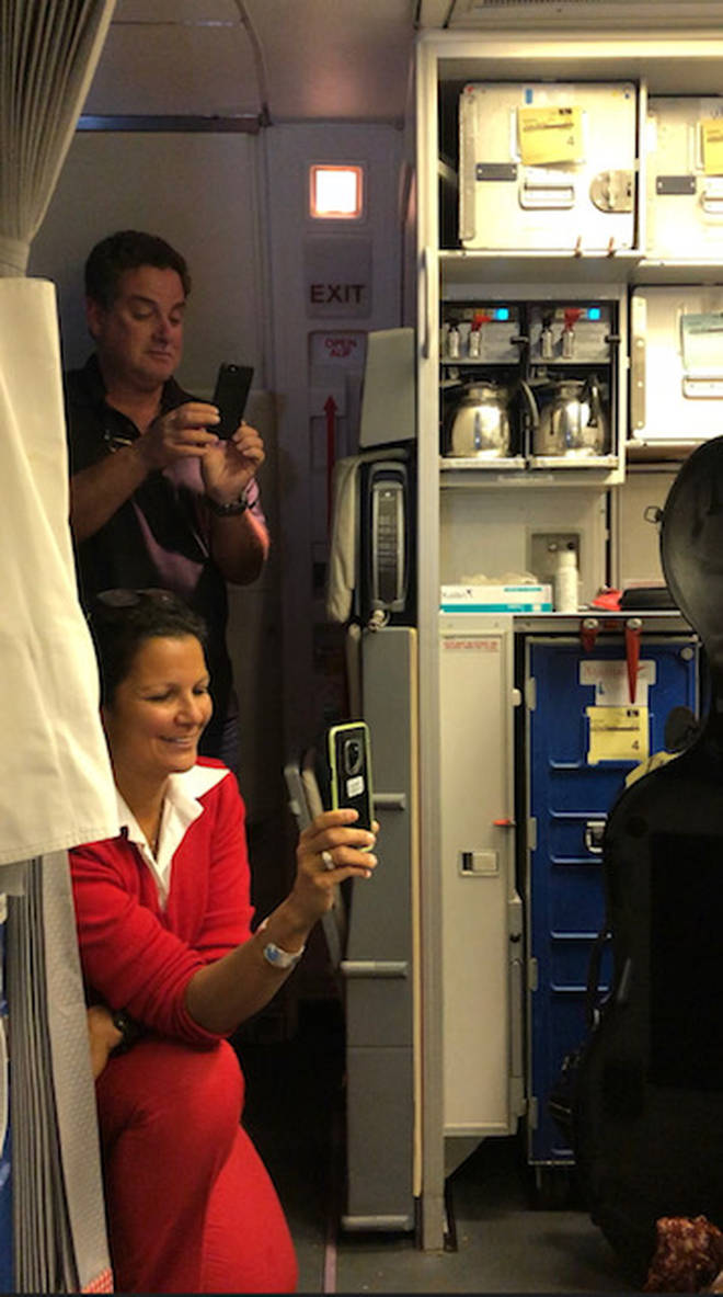 Flight attendant films cellist on board an Austrian Airlines flight.