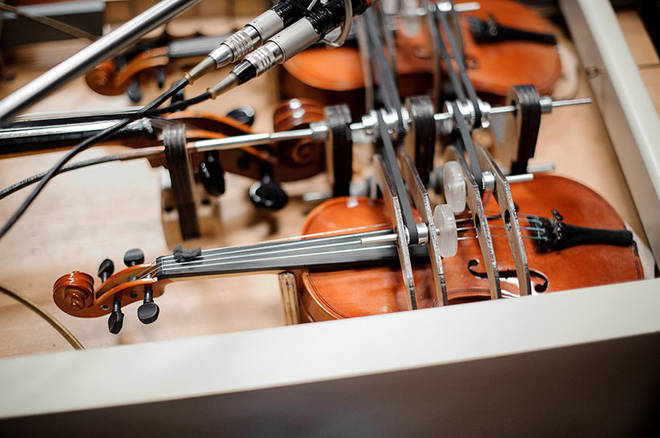 The violins are played using pedals