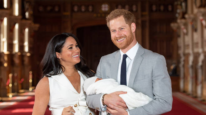 The Duke & Duchess Of Sussex Pose With Archie Their Then Newborn Son