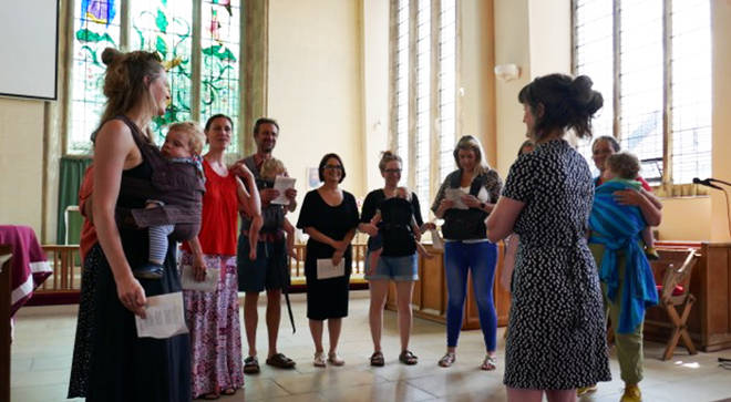 Mums sing with their babies during a Folks and Bairns choir rehearsal